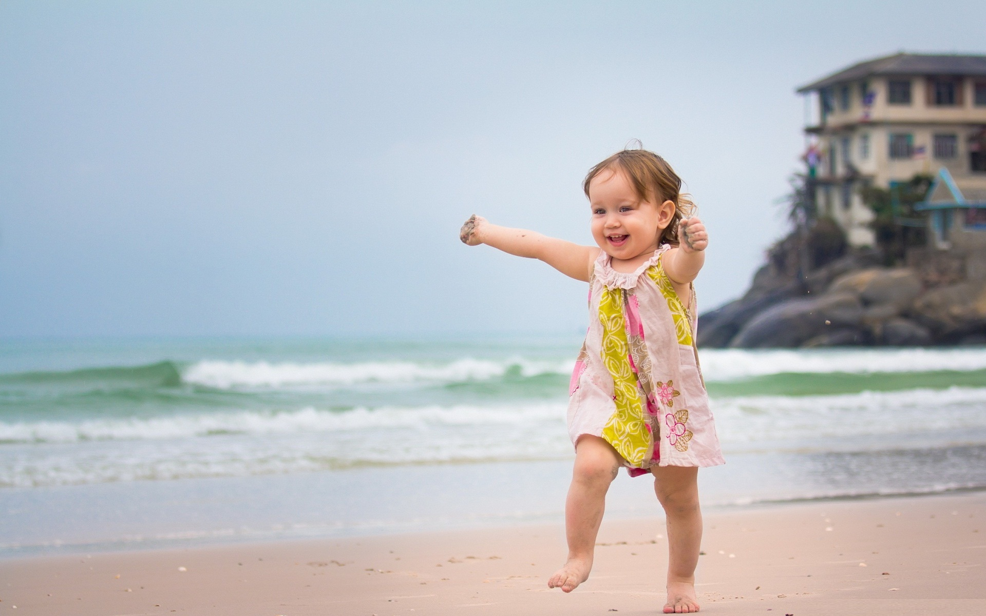 Happy mood cute baby play at beach