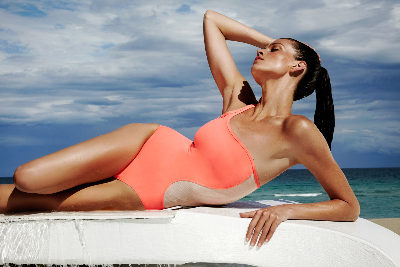 woman miami bathing suit ocean blue sky ponytail