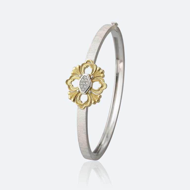 Bracciale bangle con elemento centrale in oro giallo e bianco e diamanti Buccellati gioielli