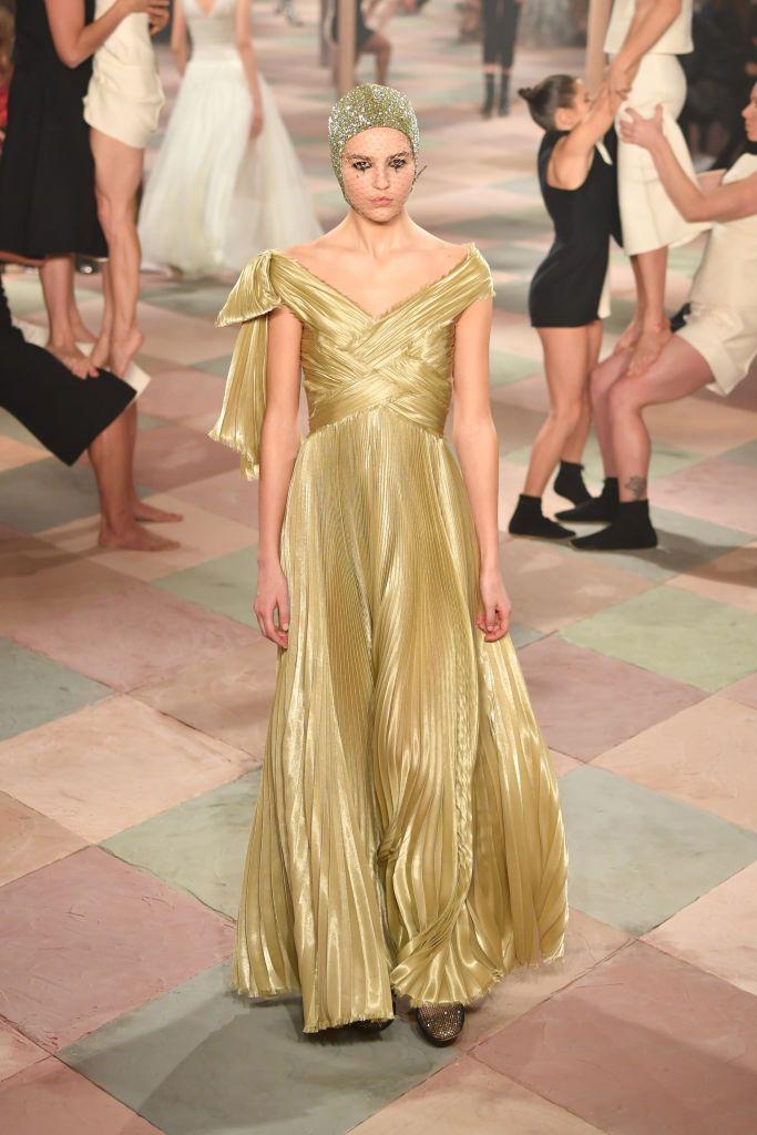 Abito dorato Dior (Photo by Pascal Le Segretain Getty Images)